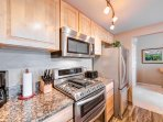 Stainless steel appliances, granite counters, coffee maker, toaster, and more.