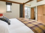 1/2 landing bedroom with 4 poster Super king bed and ensuite bathroom