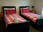 Twin room with leather beds and luxury matresses. There is a wardrobe and chest of drawers