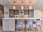 The stainless steel appliances, quartz countertops, pendant lighting, and printed tile backsplash all enhance your...