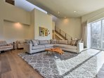 Professionally furnished, this unit is adorned with original artwork and sleek, mid-century modern furnishings.