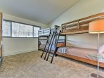 Youngsters can claim this unique bunk room that offers 2 sets of twin-over-twin beds!