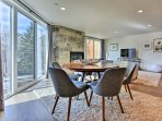 Gather at the chic breakfast bar or mid-century modern dining table with seating for 6 to share good conversation over...
