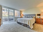 Two lucky guests can claim this downstairs master suite that provides a king-sized bed and access to the patio.
