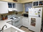 The kitchen is spacious and well stocked.