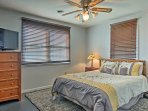 The third bedroom boasts a cloud-like queen bed and a flat-screen TV.
