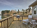 Enjoy nightly barbecues on your back deck with a charcoal grill and outdoor table!