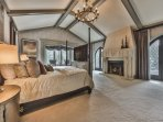 Grand Master Suite with King Bed, Hideaway Smart TV, Gas Fireplace, a Luxurious Private Bath, Siting Area and Patio...