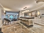 Lower Level Entertainment Room - Wet Bar and Family Room with a Shuffle Board Table, 980' Smart TV, Patio Access with...