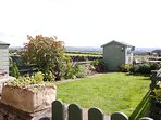 Enclosed south facing garden with fabulous views across neighbouring countryside.