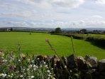 Enjoy wonderful far reaching views as you relax in the south facing enclosed garden.