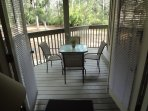 Deck, accessible from living room and master, with table and seating for four.