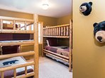 Third bedroom with two sets of bunk beds- one with additional twin trundle- located on the lower level