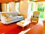 Lounge with doors onto garden