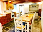 Kitchen with a dining table seating 8.