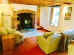 Lounge with wood burning fireplace