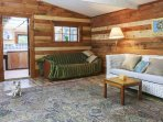 Open plan living and dining inside the Cabin