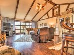 Hardwood floors and exposed beam ceilings welcome you into the open living space.