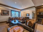 Descend the staircase to the first floor, which houses a leather sectional in the mountain-inspired entertainment room.
