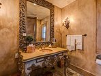 Every inch of the first Powder Room on the main floor is filled with classic design and decor.