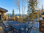 On the deck, take in the views from the outdoor fireplace or any of the many tables and sets of chairs.