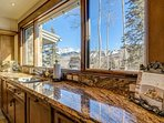 Take in the view as you prepare dinner on the granite counter tops in the kitchen.