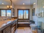 The King Guest Bathroom has a large vanity and luxurious granite counter tops.