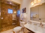 The Bunk Ensuite Bathroom is as refined as anywhere in the home, with smooth stone sinks and exquisite tile work in the...