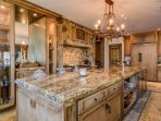A glamorous breakfast bar in the kitchen has additional seating for four.