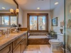 The Queen Guest Bathroom also features a stand-alone tub and shower.