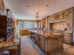 The magnificent kitchen has a massive gas range and double oven.