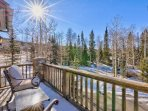 Breathe in the fresh mountain air from the chairs on the balcony outside of the King Guest Bedroom.