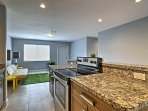 The newly remodeled kitchen features granite countertops and stainless steel appliances.