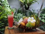 Enjoy a watermelon juice and some fruits by the pool