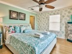 Welcome to the Master Suite with California King Bed.