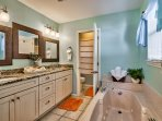 Large luxurious double vanity with incredible Jacuzzi tub and separate shower.