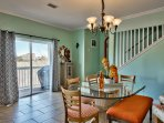 Dining leads to Balcony with BBQ shown through the glass doors. The Grillmaster will enjoy the view!