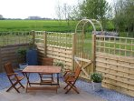 Private patio garden with views over fields and woodland
