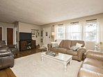 Living area features a 48' flat screen television, sound bar, Roku and WiFi.