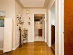 Hardwood floors throughout. Full bathroom straight ahead.