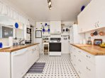 Fully equipped kitchen with all the essentials you'll need to cook meals.