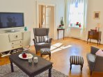 Elegant living room with TV (BBC CNN) original furnishings.
