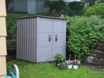 Shared shed equipped with coolers and beach pushcart buggy to carry your beach gear.