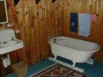Claw foot tub in master bath.