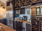 Coffee station and custom wine storage wall with large wine cooler and subzero refrigerator