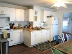 Fully equipped and updated kitchen with new floors, window treatments, fresh paint, and other upgrades!