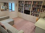 Cwtch with book and DVD library.