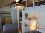Second bedroom has 1 queen, 1 full, 2 twin loft beds and beautiful lake view.