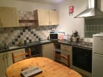 Well equipped kitchen with oven/hob,   fridge freezer,  microwave etc.