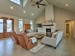 Unwind in front of the brick-mantled gas fireplace and watch film favorites on the flat-screen cable TV.